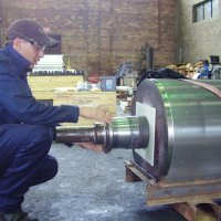 Preparing mill roll shaft for bearing assembly
