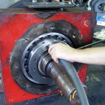 Fitting bearing housing assembly to mill roll hydraulic nut